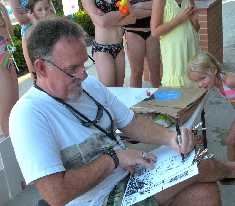 Caricaturing at a poolside event.